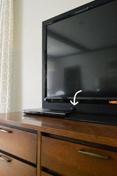 Purchase an inexpensive IR extender on Amazon for front of tv that way when using a dresser as a tv console you don't have to hinge a drawer or keep the dresser door open for remote to reach cable box. Genius! | Young House Love