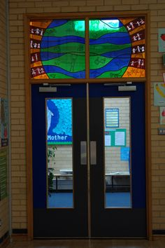 The window with the tiger and animals that the school children drew and I copied and painted on!