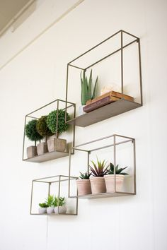"""Create a geometric arrangement with these stunning metal shelves. Place small potted plants and books upon them to give your home some flair!largest 18"""" x 5"""" x 14""""t"""