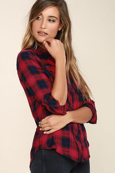 The Fiance Red Plaid Flannel Top is so cozy, it will feel like you borrowed it from that special someone! Red, navy blue, and cobalt blue plaid covers this soft woven button-up top with a collared neckline, front buttoning pockets, and long sleeves with button cuffs (and handy button-tabs).