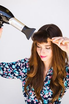 FOR STYLING BANGS: USE A SMALL ROUND BRUSH  To really get a hold of the shorter pieces around your face, use a small round brush with densely packed bristles. When blow-drying your hair, always tackle the bangs first to ensure that you get them to lie properly.