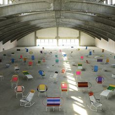 Collection of 100 chairs made in COlombia by ex-prisoners by Marni or Salone del Mibile Milano 2012.