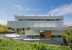 House in Toyonaka by Yo Shimada, from Tato Architects. Built in the Osaka prefecture, the house is divided into horizontal volumes, which creates a dynamic effect.