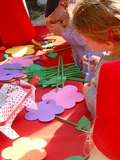 Decorating flowers at a Little Red Riding Hood party via Oh Sugar Events.