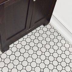 """The Daltile Octagon and Dot 2"""" x 2"""" Mosaic in Matte White with Gray Gloss Dot features an attractive design with Octagons and dots. It is constructed from ceramic and is sturdy and durable. This tile has a beautiful white finish that easily blends with most of the decors and settings. You can use this tile for installation on the countertop, shower floor, or backsplash. It is chip, scratch, rust, fade, stain, mildew, and fire resistant, which helps it maintain its look for a long ti..."""
