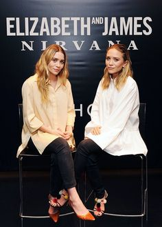 Mary-Kate Olsen wears a white button-down shirt, skinny jeans, and pom-pom embellished strappy sandals
