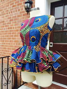 SIZE SMALL ONLY Two layers ,Ankara mix print peplum top. Can be worn with pencil skirt, jeans,, or how ever you will like to wear it. Zipper closure in