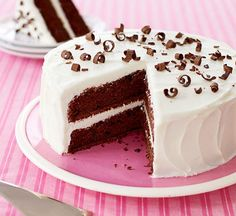 Dessert lovers will rejoice when you serve this elegant double chocolate layer cake with white chocolate frosting. Chocolate curls add the finishing touch. Double Chocolate Cake, Decadent Chocolate, Chocolate Frosting, White Chocolate, Chocolate Curls, Chocolate Shavings, Cupcake Recipes, Cupcake Cakes, Dessert Recipes