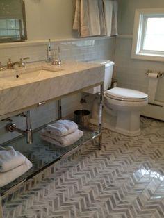 Colorful Patterned Mosaic Tile Floor In Neutral Bathroom