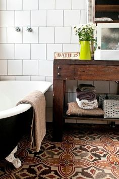 Spanish encaustic floor tiles in this Eclectic Bathroom by Etica Studio are fabulous.