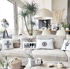 This monochrome Scandi boho living room belongs to Claudia from @belliwood _boholiving. She creates her own DIY cushions and other boho home accessories paired with this vintage wood table and various plants, creating an inspiring and beautifully individual home! Take a look...