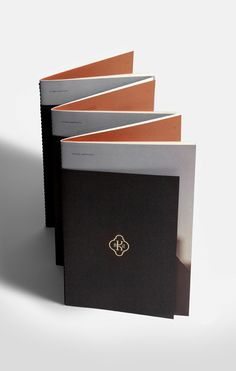"""Karipidis Winery Brochure: """"A lovely combination of white, black, and copper present the beautiful photography in this brochure in a restrained, elegant way. Bonus details like sewn binding and the shorter cover add to the sophisticated approach of this project."""" — ARMIN"""