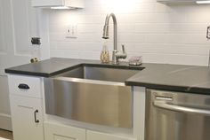 stainless steel farmhouse sink and soapstone countertop | Burritos & Bubbly