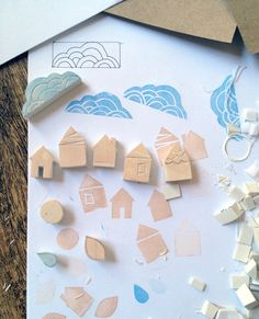 How to carve simple stamps out of erasers. Love the little houses!