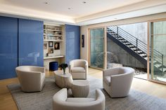 This contemporary sitting room has a hidden home office. In the adjacent light well, sculptural rock formations help create an element of interest, tying back to the outdoor landscape. Coastal Living, Coastal Decor, Coastal Curtains, Coastal Entryway, Coastal Rugs, Coastal Bedding, Modern Coastal, Coastal Farmhouse, Tiered Seating