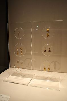 Plexiglas makes a clean display fixture and allows jewelry pieces to stand out