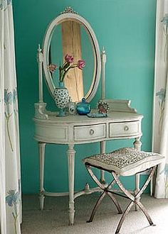 Vintage vanity & stool in a turquoise bedroom