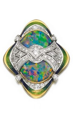 Tiffany & Co. - An Art Deco opal, enamel and diamond pendant, early 20th century. Of quatrefoil outline, set with an oval cabochon opal, framed by polychrome enamel borders and pierced millegrain-set circular- and single-cut diamond details, signed Tiffany & Co.