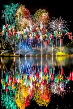 Fireworks by metrisk, via Flickr~A spectacular firework display over the lake at Saint-Yrieix-la-Perche in France