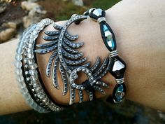 Leather wrap bracelet with peacock feather, made by Dizzy Bees, found on facebook!