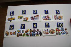 M.     Mengenkarten - Tonkarton, Wachsmalblöcke (für einen schönen Rand), Bildchen (Spielzeugkataloge), Fühlziffern, Muggelsteine