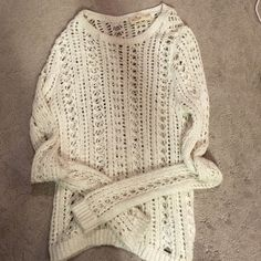 White hole sweater Cute white sweater with holes. Great condition. Make me an offer. :) Hollister Sweaters Shrugs & Ponchos