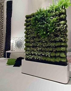 'Mobile plant wall' by Greenworks. Moving Hedge is a double-sided plant wall on wheels with automatic watering system and pockets for plants. The wall is perfect as room-divider in office spaces, a corner builder for recreation spots or a green boost at any other public space that can benefit from air-cleaning, sound absorbing and overall aesthetic functions.