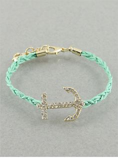 Be ready to set sail in this braided anchor bracelet. The braided bracelet hints of a rope, and we love this delicate and subtle charm. Bracelet is adjustable fit.
