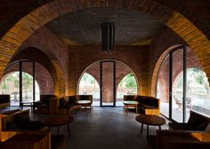 Wangstudio's F Coffee is a Vietnam cafe built with brick arches