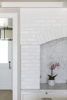 Brick Kitchen Hood. White Brick Stove Accent: Reclaimed white painted brick…