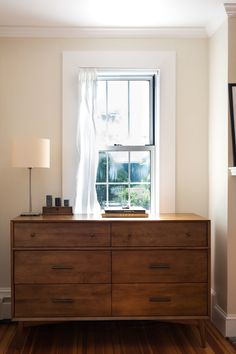 The West Elm dresser exudes shaker simplicity and minimalism in this serene space. Amy & Peter's Minimalist Home with Latin American Roots