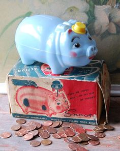 Snooty The Piggy Bank. I had a yellow one and remember how the hat would mechanically rise when you put a coin in the slot.