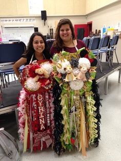 We had the biggest mums in school that also; lit up, had a pocket for our phones in the back, had a crazy comfy neck strap, and played music! Everything is personalized, glittered and bedazzled right down to the paws of Simba and Nala
