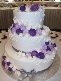 Calumet Bakery Wedding cake with white on white scrollwork and gum paste flowers.