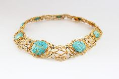 A beautiful and rare gold wire turquoise necklace from the 1910s (Art Nouveau), beautifully set with 9 gold-inlaid Iranian turquoises depicting Arabic scriptures. This piece combines the French chic of the Art Nouveau with the historic Arabic culture. Find it tonight at The Winter Olympia Art & Antiques Fair!