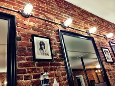 Exposed brick with metal conduit for lighting