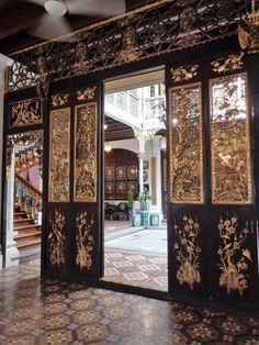 Intricate wood panelling and Peranakan tiles