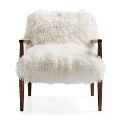 A retro design with a softer side, the Arhaus Tansy Chair in Tibetan Ivory Sheepskin takes shape with the smooth, clean lines of its modern frame.