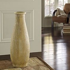 @Overstock.com - This elegantly sleek and simple PoliVaz whitewash decorative vase is hand-painted with a textured paint that combines flawless beauty with design finesse. This vase is crafted by artisans in Indonesia.http://www.overstock.com/Worldstock-Fair-Trade/Whitewash-Medium-Floor-Vase-Indonesia/5547946/product.html?CID=214117 $123.04