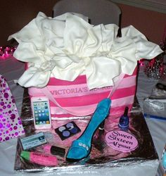 This cake was for a sweet sixteen party and included gum paste accessories.