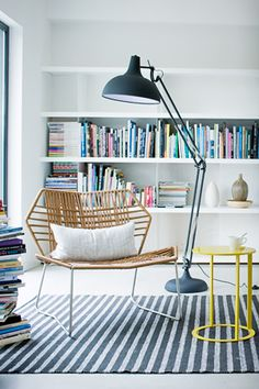 I am so addicted to black/white striped carpets and black lamps...