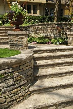 Natural Stone Retaining Walls: I like how this curves to the steps.