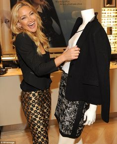 Golden girl: Kate Hudson was all smiles in her favorite store, Ann Taylor Flatiron, in NYC on Wednesday