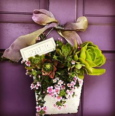 Greeting clients with a little surprise on the front door. #bacopa #pink #succulents #spring #nosegay #frontdoor #greetings #contractor #gardenplans #landscapedesigner #horticulturist #plantlady #womeninbusiness #frillythings #makesmehappyeveryday#lovemyj