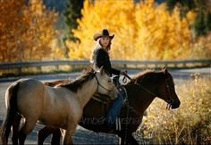Shawn took this picture of Amber on a horse & leading her 4 year old Quarter Horse Buckskin Cash!!