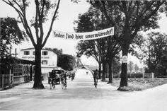 "A banner reading ""Jews are not wanted here"" hangs over the entrance to the village of Rosenheim in Bavaria."