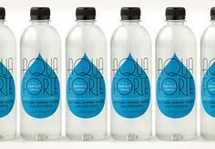 Louise Fili Ltd, Aqua Forte — The only bottled water produced by a dentist, Aqua Forte is natural spring water with added fluoride for a dazzling smile. Water Packaging, Beverage Packaging, Bottle Packaging, Bottle Labels, Food Packaging Design, Brand Packaging, Label Design, Graphic Design, Package Design