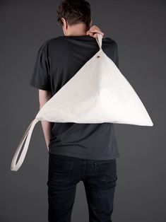 Otaat Bagby > Los Angeles-based design label Otaat has released a second series of modern canvas carriers designed by creative director Albert Chu. Joining the Bagby and Tu Bag, the Space Bag and Canoe Bag follow in the same Otaat tradition of multi-function and usability while teetering on the absurd.