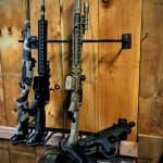 When you think of the classic gun rack, visions of a single-shot shotgun perched in a cheap pine, plywood or particle board cradle may come to mind. Homemade Shotgun, Tactical Wall, Gun Rooms, Bolts And Washers, Rubber Grommets, Wood Rack, Slat Wall, Wall Racks, Hold Ups
