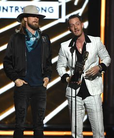 LAS VEGAS, NV - MAY 21:  Musicians Brian Kelley (L) and Tyler Hubbard of Florida Georgia Line accept Top Country Song for 'H.O.L.Y.' onstage during the 2017 Billboard Music Awards at T-Mobile Arena on May 21, 2017 in Las Vegas, Nevada.  (Photo by Ethan Miller/Getty Images) via @AOL_Lifestyle Read more: https://www.aol.com/article/entertainment/2017/05/21/drake-to-billboard-music-awards-host-vanessa-hudgens-during-acce/22102498/?a_dgi=aolshare_pinterest#fullscreen